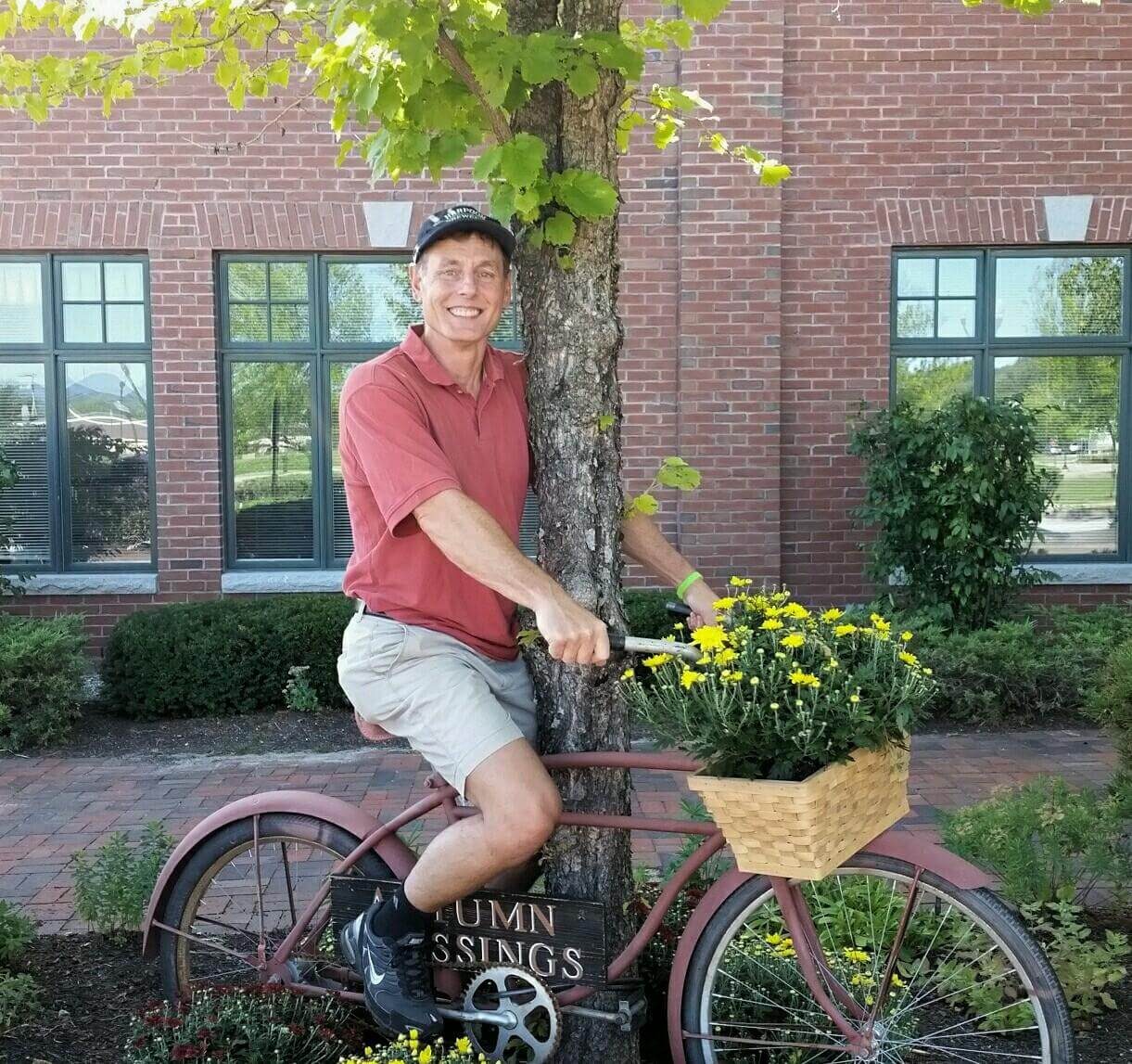 Barry posing on the vintage bicycle decorating the Bethel branch