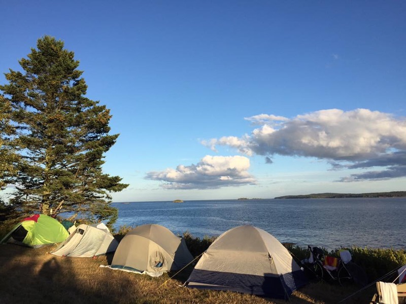 Tents set up on water front