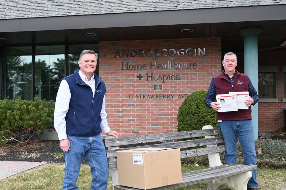 Mike Noble from NSB delivers a box of N95 face masks to Ken Albert at Androscoggin Home Healthcare & Hospice.
