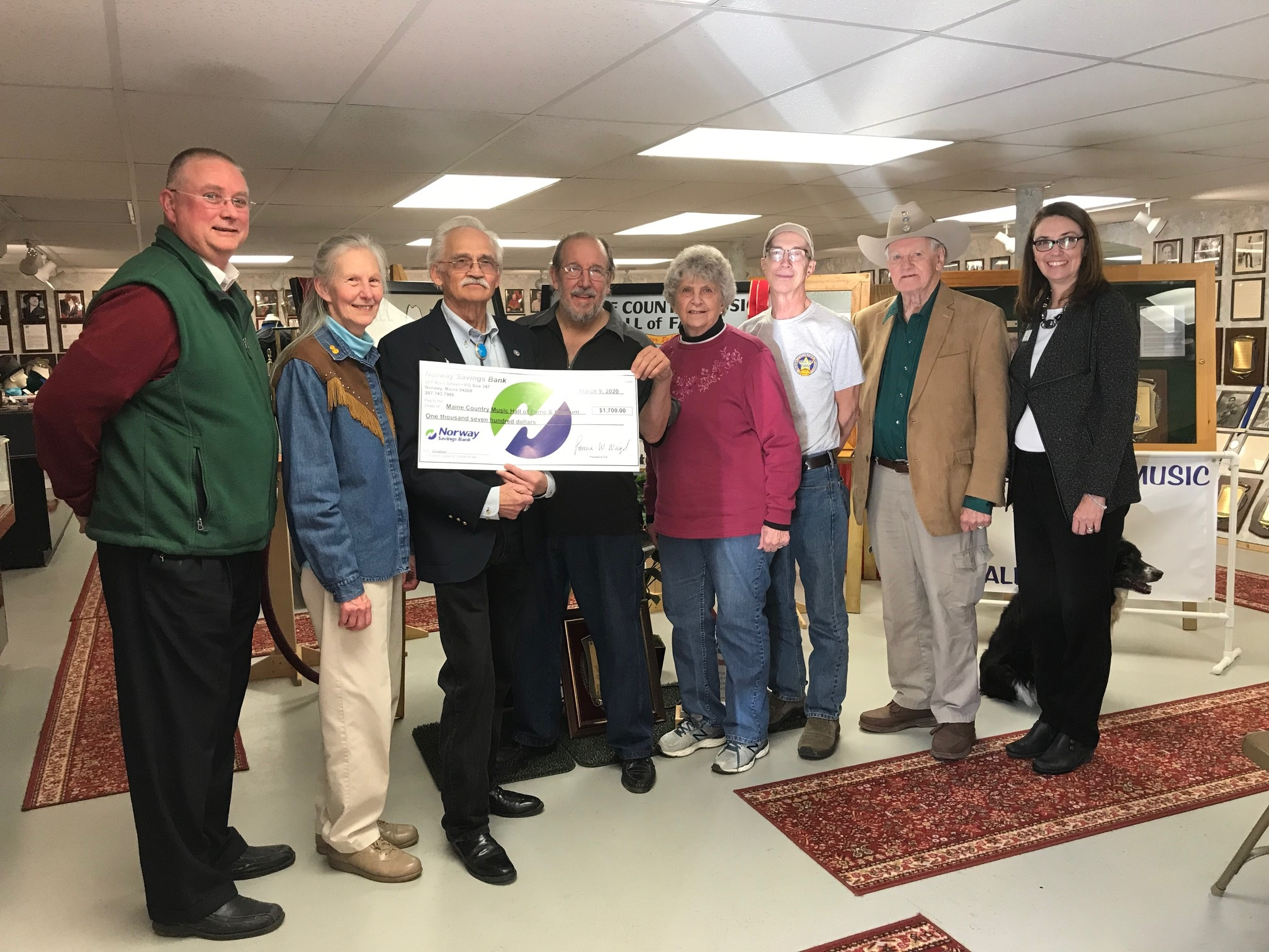 NSB employees present check for $1,700 to members of the Maine Country Music Museum and Hall of Fame