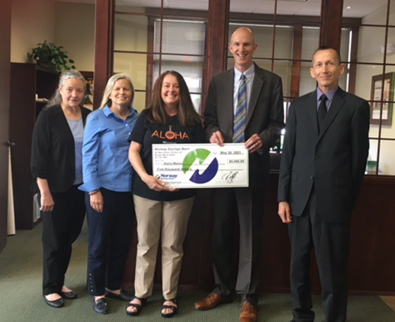 NSB employees presenting a check